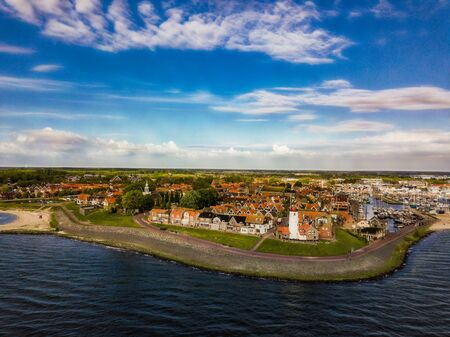 Aerial view of Urk with its lighthouse a small town on the IJsselmeer Stock Photo