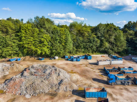 Aerial view of a recycling yard with trucks and containers. Stock Photo