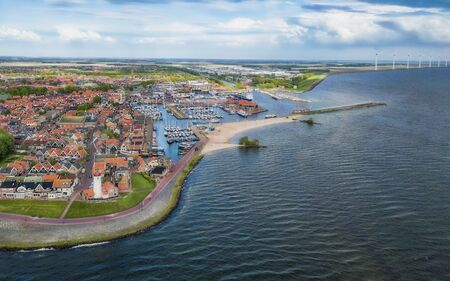 Aerial view of Urk with its lighthouse, a small coastal village on the IJsselmeer in the Netherlands.