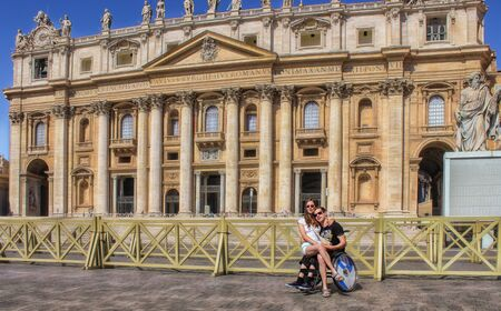 Disabled boy with girlfriend in front of St. Peters Basilica in Rome. Stock Photo
