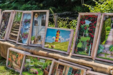 Engelskirchen, Germany - June 30, 2019: Pictures sale on a garden market in Engelskirchen - Germany