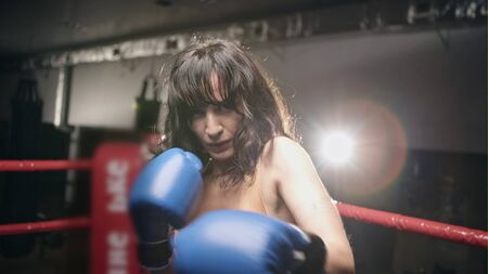 Young boxing girl doing exercises Stock Photo