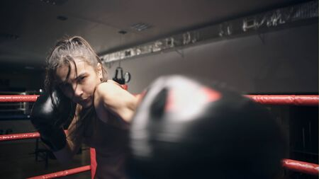 Young beautiful girl persistently stalled in camera in the ring Stock Photo