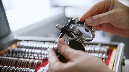 Old retro optometrist diopter tool in an optician laboratory Фото со стока