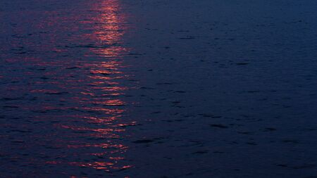 Sunset reflecting on the surface of lake water.