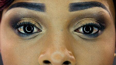 Closeup of beautiful eyes skinned girls with makeup