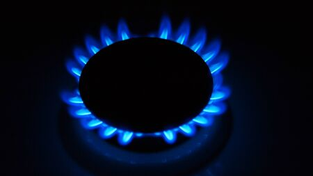 Burning blue gas. Focus on the front edge of the gas burners.