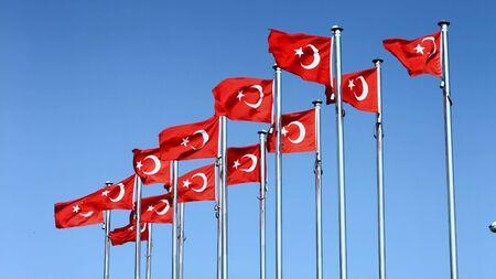 Turkish flag waving on the sky. Фото со стока