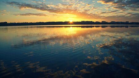 Nice landscape with sunset on lake Фото со стока