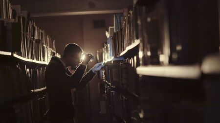 Student with glasses came to the library at night