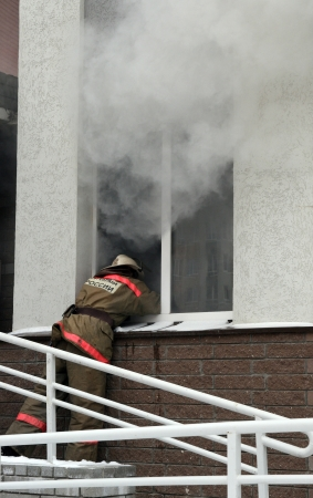 fireman at smoking window