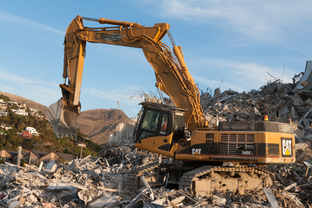 Christchurch, New Zealand - May 20, 2012: Ceres CAT Excavator is helping with the clean-up after the series of devastating earthquakes that have hit Christchurch Editorial