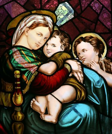 Stained glass depicting the Virgin Mary holding baby Jesus, Church of the Sacred Heart of Jesus, Zagreb, Croatia photo