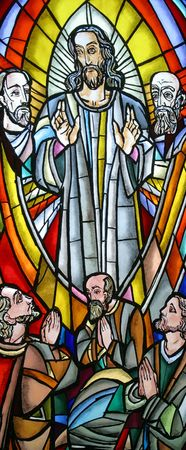 Transfiguration of Jesus, a bright and colorful stained glass window Stock Photo