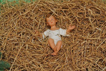A baby Jesus figure on Christmas photo