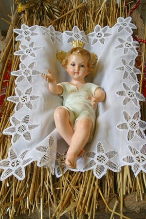 A baby Jesus figure on Christmas photo