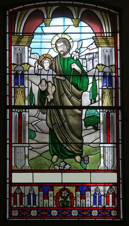 to confess love: Stained glass with st. Joseph holding baby Jesus Stock Photo
