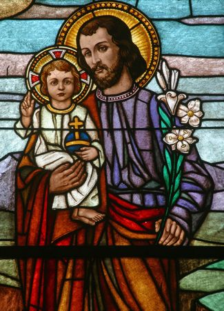 saint mary: Stained glass with st. Joseph holding baby Jesus Stock Photo