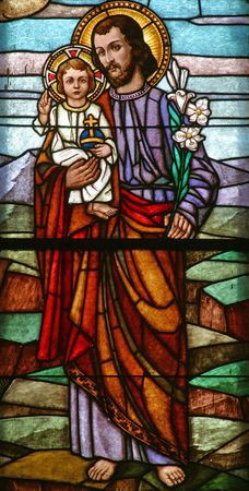 confess: Stained glass with st. Joseph holding baby Jesus Stock Photo