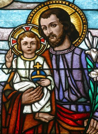 baby jesus: Stained glass with st. Joseph holding baby Jesus Stock Photo