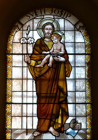 confess: Stained glass with Saint Joseph Stock Photo