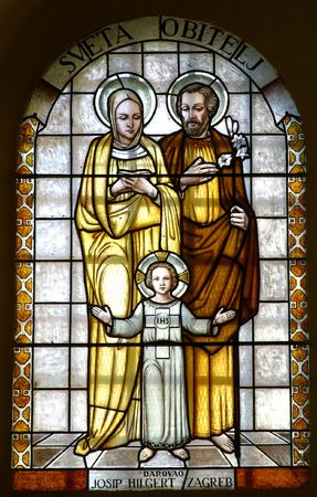 confess: Stained glass with Holy family Stock Photo