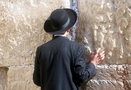 Orthodox man prayers at Western wall of Jerusalem photo