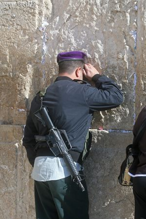 hasidim: Israeli soldier praying at the Western Wall in Jerusalem Israel