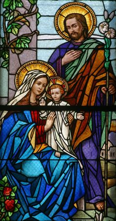 confess: Stained glass with Holy Family