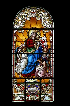 catholic stained glass: Virgin Mary with baby Jesus and angels