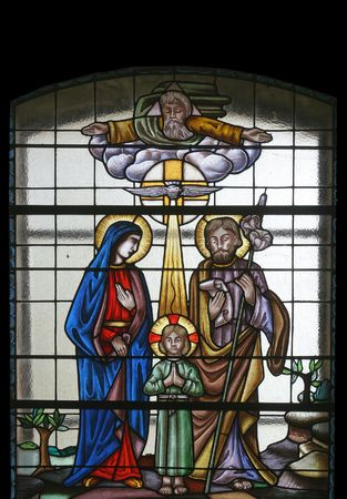 confession: Stained glass with Holy Family