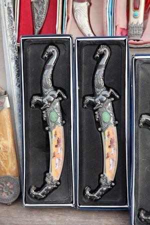 Arabian souvenirs - Oriental knife with ornament photo