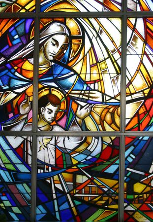 Virgin Mary with child Jesus, stained glass photo