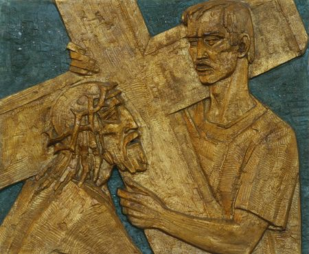 5th Station of the Cross - Simon of Cyrene carries the cross photo