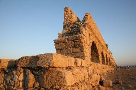 Ancient Roman aqueduct at Caesaria, in Israel. photo