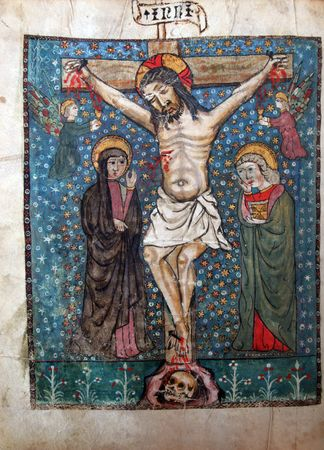 Crucifixion, Jesus dies on the cross. Close up of old Holy Bible book photo