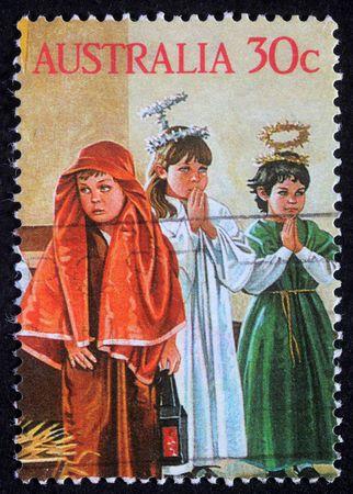 AUSTRALIA - CIRCA 2004: A greeting Christmas stamp printed in Australia shows children play to the Holy Family, circa 2004 Stock Photo - 8126895