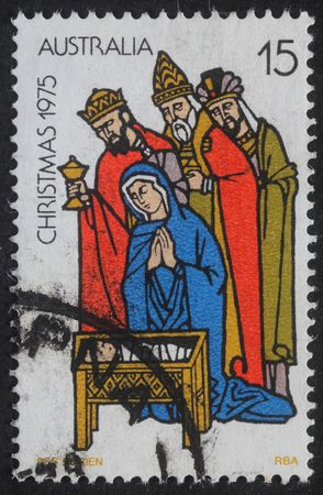 AUSTRALIA - CIRCA 1975: A greeting Christmas stamp printed in Australia shows birth of Jesus Christ, adoration of the Magi, circa 1975 photo