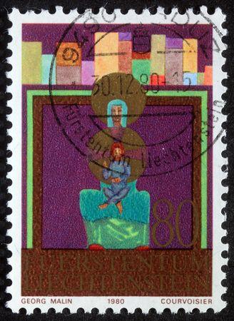 LIECHTENSTEIN - CIRCA 1980: A greeting Christmas stamp printed in Liechtenstein shows Madonna and Child, circa 1980 photo