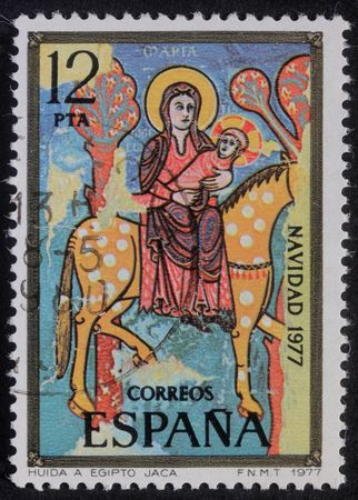 Spain - CIRCA 1977: A greeting Christmas stamp printed in Spain shows Flight to Egypt, circa 1977 photo