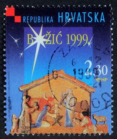 creche: Croacia - CIRCA 1999: Un saludo navide�o sello impreso en los shows de Croacia guarder�a de Navidad, alrededor del a�o 1999  Foto de archivo