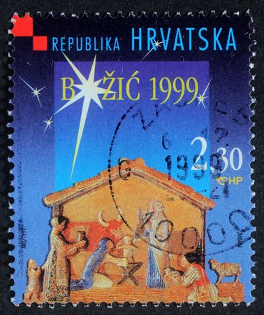 CROATIA - CIRCA 1999: A greeting Christmas stamp printed in the Croatia shows Christmas Creche, circa 1999 Stock Photo - 8126931