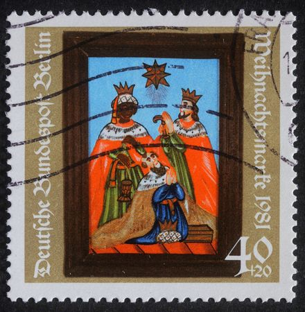 GERMANY - CIRCA 1981: A greeting Christmas stamp printed in the Germany shows birth of Jesus Christ, adoration of the Magi, circa 1981 photo