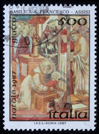 ITALY - CIRCA 1987: A greeting Christmas stamp printed in Italy shows draw by artist Giotto -  Birth of Jesus Christ, circa 1987 photo