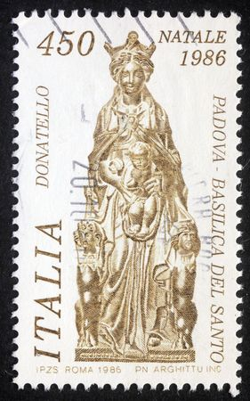 memling: ITALY - CIRCA 1986: A greeting Christmas stamp printed in Italy shows sculpture by artist Donatelo -  Madonna with child, circa 1986