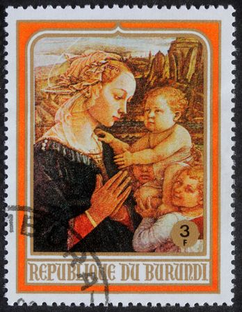 BURUNDI - CIRCA 1980: A greeting Christmas stamp printed in Burundi shows Madonna and Child, circa 1982 photo
