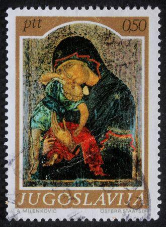YUGOSLAVIA - CIRCA 1974: A greeting Christmas stamp printed in Yugoslavia shows Madonna and Child, circa 1985 photo