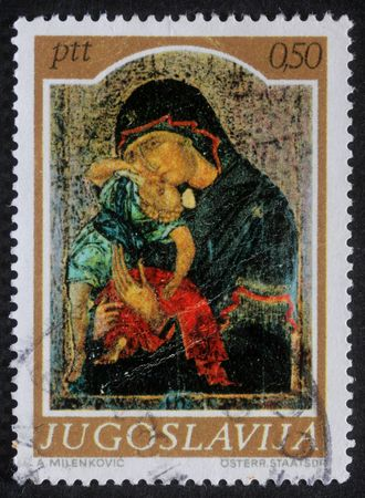 yugoslavia: YUGOSLAVIA - CIRCA 1974: A greeting Christmas stamp printed in Yugoslavia shows Madonna and Child, circa 1985