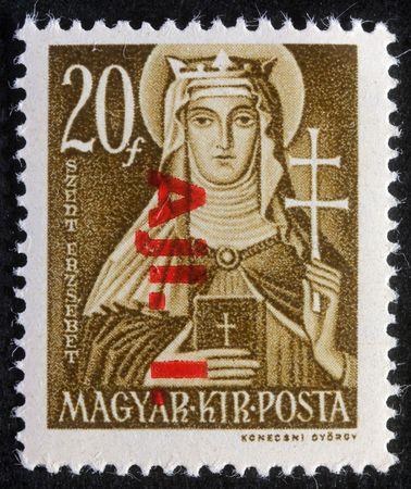 HUNGARY - CIRCA 1944: Stamp printed in Hungary shows Saint Elisabeth of Hungary, circa 1944 photo