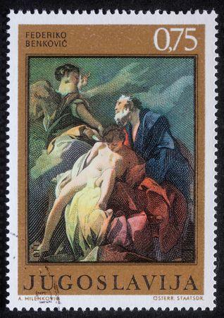 YUGOSLAVIA - CIRCA 1985: Stamp printed in Yugoslavia shows Abraham Sacrificing Isaac, circa 1985 photo